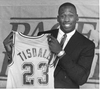 This Oct. 10, 1985 file photo shows Wayman Tisdale, holding up his the Indiana Pacer jersey after he signed his contract with the team in Indianapolis. Tisdale, a three-time All-American at Oklahoma who played 12 seasons in the NBA, has died after a two-year battle with cancer. He was 44. (AP Photo/Michael Conroy, File)