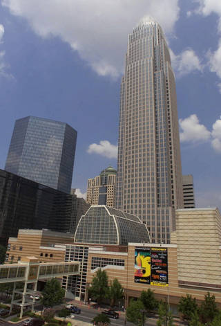 Bank of America's corporate center, right, is shown in downtown Charlotte, N.C., Friday, July 28, 2000. Bank of America and FleetBoston Financial Corp. won approval from the Federal Reserve on Monday, March 8, 2004, for a merger creating the third-largest U.S. bank, a behemoth holding nearly $1 trillion in assets and stretching from California through the South and up to New England. (AP Photo/Chuck Burton)