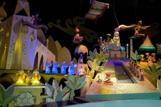 """This Jan. 23, 2009 file photo shows the characters Aladdin, Jasmine and Abu from the film, """"Aladdin,"""" on the """" It's A Small World"""" ride, at Disneyland in Anaheim, Calif. An attorney says a disabled man, Jose Martinez, was awarded $8,000 by Disneyland after the """" It's A Small World"""" ride broke in 2009, stranding him for half an hour while the theme song played continuously. (AP Photo/Damian Dovarganes, File)"""
