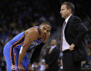 Oklahoma City Thunder coach Scott Brooks, right, speaks with Russell Westbrook during the first half of an NBA basketball game against the Golden State Warriors, Thursday, Nov. 14, 2013, in Oakland, Calif. (AP Photo/Ben Margot)