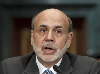Federal Reserve Board Chairman Ben Bernanke testifies on Capitol Hill in Washington, Thursday, March 1, 2012, before the Senate Banking Committee to deliver his twice-a-year monetary report to Congress. (AP Photo/J. Scott Applewhite) ORG XMIT: DCSA101
