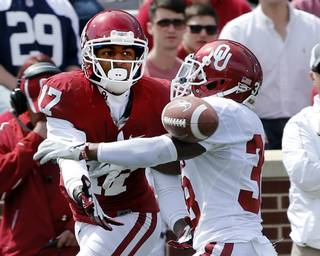 Brandon Young (38) breaks up a pass itended for Trey Metoyer (17) during the annual Spring Football Game at Gaylord Family-Oklahoma Memorial Stadium in Norman, Okla., on Saturday, April 13, 2013. Photo by Steve Sisney, The Oklahoman