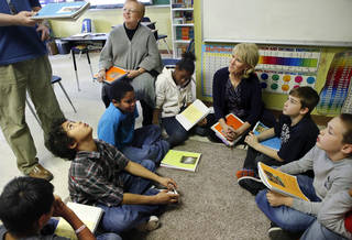 "Seated in chair at upper left is Patricia Webb, executive director of The Silence Foundation. Seated on the floor, in center, is Cathy O'Conner,Resilience Project facilitator. Students gather in a circle near the door of the classroom to share their poetry. Some students at Positive Tomorrows, a school for homeless children, participate in the ""Resillience Project"" on Monday, March 4, 2013. Photo by Jim Beckel, The Oklahoman Jim Beckel - THE OKLAHOMAN"