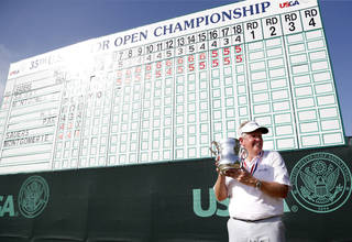 Colin Montgomerie holds the Francis D. Ouimet trophy following the final round of the U.S. Senior Open golf tournament at Oak Tree National in Edmond, Okla., Sunday, July 13, 2014. Photo by Sarah Phipps, The Oklahoman