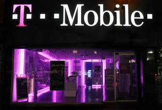 "A T-Mobile store in New York is seen. The Federal Trade Commission alleged Tuesday that T-Mobile USA Inc. made ""hundreds of millions"" of dollars off its customers through bogus charges. AP Photo Mark Lennihan - AP"