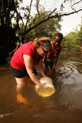 After completing a 20-minute water walk, gospel recording artist Sandi Patty fetches water with villagers in Sierra Leone, Africa, from their local water source. Photo provided