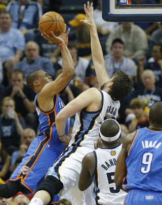 Oklahoma City's Russell Westbrook (0) puts up a shot over Memphis' Marc Gasol (33) during Game 3 in the first round of the NBA playoffs between the Oklahoma City Thunder and the Memphis Grizzlies at FedExForum in Memphis, Tenn., Thursday, April 24, 2014. Memphis won 98-95. Photo by Bryan Terry, The Oklahoman