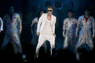Canadian singer Justin Bieber performs on stage during his concert in Telenor Arena in Oslo, Tuesday 16 April 2013. (AP Photo/ Lise Aserud, NTB scanpix)