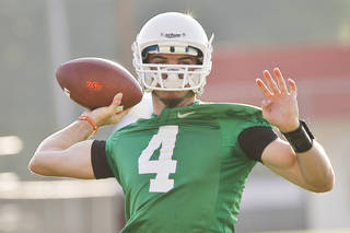 OSU COLLEGE FOOTBALL: Freshman quarterback J.W. Walsh throws the ball during OSU's first practice of the season on the campus of Oklahoma State University in Stillwater, Okla. on Friday, August 5, 2011. Photo by Zach Gray ORG XMIT: KOD