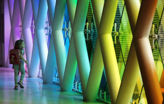 A girl walks past a multi-color art installation at the Miami International Airport on July 3. AP Photo J Pat Carter