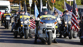 Patriot Guard Riders participate in last year's Veterans Day parade in Norman. PHOTOs BY PAUL B. SOUTHERLAND, OKLAHOMAN ARCHIVES