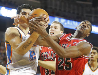 Oklahoma City Thunder's Steven Adams, left, and Chicago Bulls' Marquis Teague (25) battle for a rebound in the second quarter during their preseason NBA basketball game in Wichita, Kan., Wednesday, Oct. 23, 2013. (AP Photo/The Wichita Eagle, Fernando Salazar) LOCAL TV OUT; MAGAZINES OUT; LOCAL RADIO OUT; LOCAL INTERNET OUT