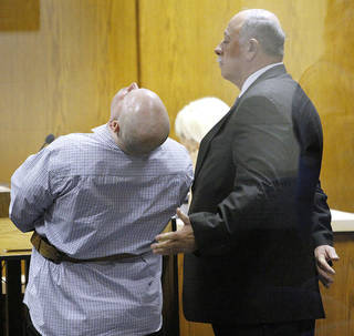 Joshua Steven Durcho, left, weeps as defense attorney WayneWoodyard comforts him as family members read statements during a plea agreement hearing in the Canadian County Courthouse in El Reno, Friday September 14, 2012. Durcho, 29, of El Reno, was sentenced to five consecutive life terms without the possibility of parole after he pleaded guilty to murdering his girlfriend, Summer Rust, and her four children. Photo By Steve Gooch, The Oklahoman