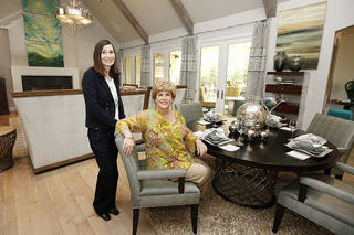 Dana Galiga, left, and Teresa Pope, co-chairmen, are shown in the living room of 1501 NW 158, one three new houses in this year's Symphony Show House fundraiser by the Oklahoma City Orchestra Leauge. PAUL HELLSTERN - The Oklahoman