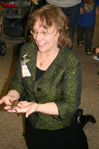 Basha Hartley holds a creepy-crawly friend at a recent Bug Day at the Norman Public Library.