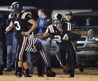 Josh Way (24) of Wayne celebrates a touchdown next to teammate Louden Johnson (3) during a high school football playoff game between Wayne and Minco in Wayne, Okla., Friday, Nov. 25, 2011. Photo by Nate Billings, The Oklahoman