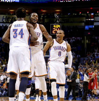 L.A. CLIPPERS / REACTION: Oklahoma City's Hasheem Thabeet (34), Kevin Durant (35), and Russell Westbrook (0) react during an NBA basketball game between the Oklahoma City Thunder and the Los Angeles Clippers at Chesapeake Energy Arena in Oklahoma City, Wednesday, Nov. 21, 2012. Photo by Bryan Terry, The Oklahoman