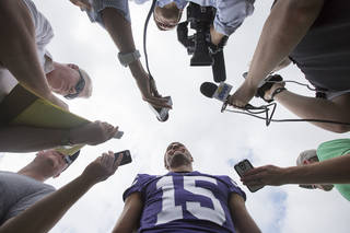 Kansas State quarterback Jake Waters is interviewed by reporters during Kansas State's media day on Monday, Aug. 5, 2013 in Manhattan, Kan. Waters, a junior college transfer, will compete for the starting quarterback job. (AP Photo/The Wichita Eagle, Travis Heying) ORG XMIT: KSWIE101