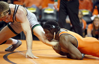 Binghamton University's Nate Schiedel wrestles OSU's Chris McNeil in the 184-pound bout during an college wrestling match between the Oklahoma State University and Binghamton University at Gallagher-Iba Arena in Stillwater, Okla., Sunday, Jan. 29, 2012. Photo by Sarah Phipps, The Oklahoman ORG XMIT: KOD