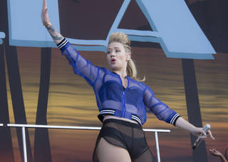 Australian singer Iggy Azalea performs on the main stage at Wireless festival in Finsbury Park, north London, Friday, July 4, 2014. The first festival took place in June 2005 and was staged in Hyde Park. AP Photo
