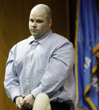 Joshua Steven Durcho appears in a hearing Monday in El Reno. The hearing will determine whether prosecutors can seek the death penalty. AP photo
