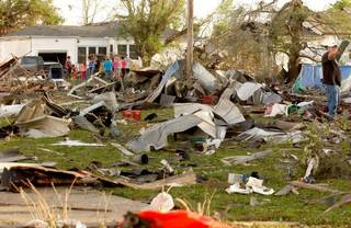 Quapaw residents survey the damage in a residential neighborhood struck by a tornado on Sunday evening. GARY CROW, For the Tulsa World -