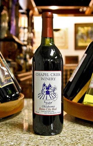A bottle of red wine created at Chapel Creek Winery in El Reno. Photo by Chris Landsberger, The Oklahoman CHRIS LANDSBERGER