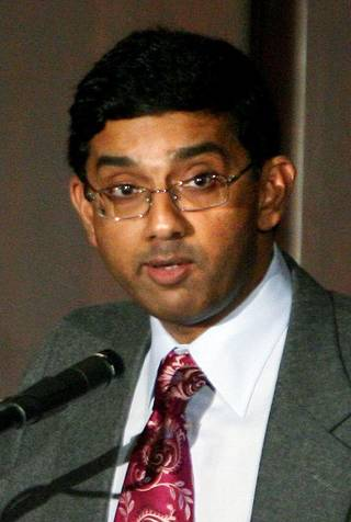 FILE - This Feb. 1, 2007 file photo shows Dinesh D'Souza in Williamsburg, Va. The conservative scholar behind a high-grossing film that condemns President Barack Obama resigned Thursday, Oct. 18, 2012 as head of an evangelical college after a report about his engagement to a woman while still legally married to his wife. (AP Photo/Daily Press, Heather S. Hughes)