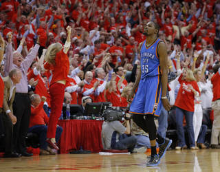 Oklahoma City's Kevin Durant (35) walks off the court as the crowd reacts to Houston's win in Game 4 in the first round of the NBA playoffs between the Oklahoma City Thunder and the Houston Rockets at the Toyota Center in Houston, Texas,Sunday, April 29, 2013. Oklahoma City lost 105-103. Photo by Bryan Terry, The Oklahoman