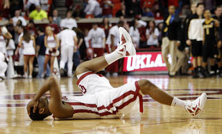 OU's Steven Pledger (2) reacts to missing a three-point shot as time expired that would have tied the game after a men's college basketball game between the University of Oklahoma Sooners and University of Missouri Tigers at the Lloyd Noble Center in Norman, Okla., Monday, Feb. 6, 2012. Missouri won, 71-68. Photo by Nate Billings, The Oklahoman