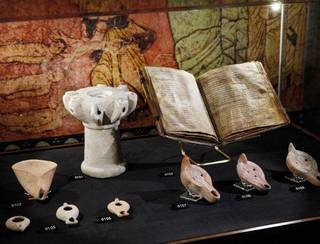 "These items are on display in ""Passages,"" a traveling exhibition of rare biblical texts and assorted artifacts featured at the Oklahoma City Museum of Art. Photo by Jim Beckel, The Oklahoman JIM BECKEL"