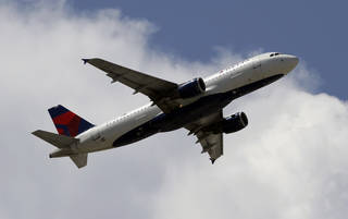 A Delta Air Lines aircraft taking off from Miami International Airport in Miami. AP File Photo Alan Diaz -