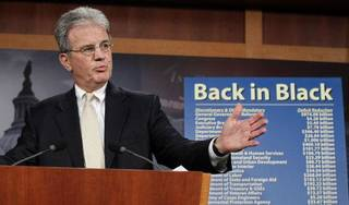 """Sen. Tom Coburn, R-Okla., reveals his """"Back in Black"""" plan to reduce the federal deficit, Monday, July 18, 2011, during a news conference on Capitol Hill in Washington. (AP Photo/J. Scott Applewhite) ORG XMIT: DCSA104"""