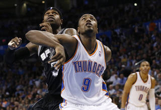 Oklahoma City Thunder forward Serge Ibaka (9) and San Antonio Spurs guard Stephen Jackson (3) fight for position during a foul shot in the fourth quarter of an NBA basketball game in Oklahoma City, Monday, Dec. 17, 2012. Oklahoma City won 107-93. (AP Photo/Sue Ogrocki) ORG XMIT: OKSO104