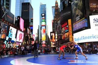Coleman Scott, right, competes with Shawn Bunch during the Grapple in the Apple freestyle wrestling event in New York's Times Square, Thursday, June 7, 2012. Scott secured the victory over Bunch with a five-point throw in the second period of the third match. (AP Photo/Frank Franklin II) ORG XMIT: NYFF102