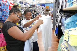 Dearius Gardner, 13, and his mom, Delisha, look for school clothing at the Belle Isle Wal-Mart during the tax-free weekend. Photo by Paul Hellstern, The Oklahoman PAUL HELLSTERN - Oklahoman