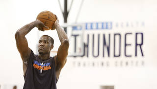 Oklahoma City Thunder's Kendrick Perkins shoots free throws during practice in Oklahoma City, March 1 , 2011. Photo by Steve Gooch, The Oklahoman