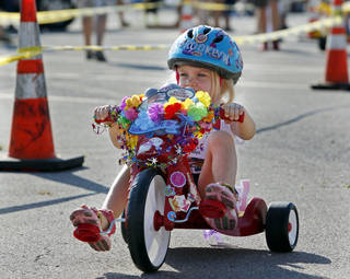 Brooklyn Phillips, 3, competes Saturday in The Ride, a children's big-wheel race benefiting benefits United Way. PHOTO BY STEVE SISNEY, THE OKLAHOMAN STEVE SISNEY -