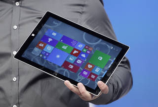 Panos Panay, Microsoft's vice president for surface computing, introduces the Surface Pro 3 tablet device at a media preview, Tuesday, May 20, 2014 in New York. The device will have a screen measuring 12 inches diagonally, up from 10.6 inches in previous models. Microsoft says it's also thinner and faster than before. (AP Photo/Mark Lennihan)