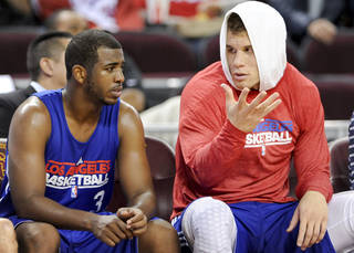 L.A. CLIPPERS: Los Angeles Clippers guard Chris Paul (3) talks with forward Blake Griffin, right, during an NBA basketball scrimmage, Sunday, Dec. 18, 2011, in Los Angeles. (AP Photo/Gus Ruelas) ORG XMIT: CAGR112