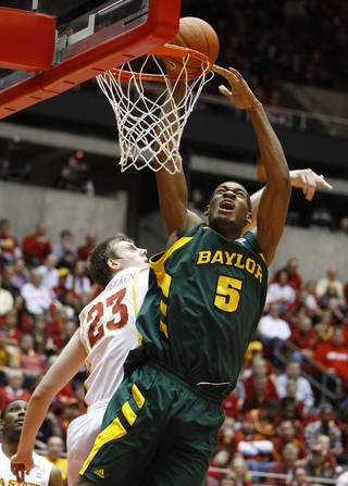 Baylor center Perry Jones drives to the basket past Iowa State forward Jamie Vanderbeken, left, during the first half of an NCAA college basketball game, Saturday, Jan. 15, 2011, in Ames, Iowa. (AP Photo/Charlie Neibergall) ORG XMIT: IACN105