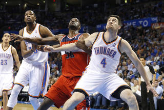 Oklahoma City Thunder forward Kevin Durant (35), Washington Wizards center Emeka Okafor (50) and Thunder forward Nick Collison (4) fight for position on a foul shot in the first quarter of an NBA basketball game in Oklahoma City, Wednesday, March 27, 2013. (AP Photo/Sue Ogrocki) ORG XMIT: OKSO103