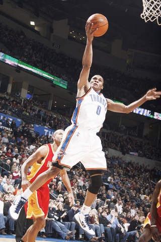 Thunder point guard Russell Westbrook shoots a layup during Oklahoma City's 100-91 loss to Houston on Sunday. PHOTO BY SARAH PHIPPS, THE OKLAHOMAN