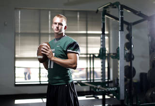 Edmond Santa Fe quarterback Justice Hansen poses for a portrait at Edmond Santa Fe for the Super 30 on Thursday, July 11, 2013. Photo by Bryan Terry, The Oklahoman