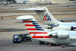 Crews work around two American Airlines jets in St. Louis. AP File Photo Bill Montgomery - AP