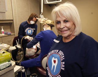 Shirley Harris, executive director for Dentists of the Disabled and Elderly in Need of Treatment, works with patients at community dental day at the Tower Dental Clinic in Edmond, OK, Saturday, January 4, 2014, Photo by Paul Hellstern, The Oklahoman