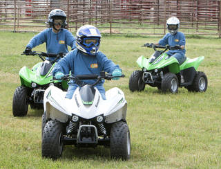 Jared Welch maneuvers during a 2012 children's ATV safety course at the Logan County Fairgounds. Photo By Paul Hellstern, The Oklahoman Archives