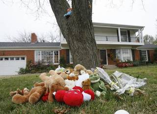 A memorial has been started by neighbors and friends outside the home of 9 -year -old Tommy Wolf in Nichols Hills. Tommy was stabbed to death early Monday. His father, Dr. Stephen Paul Wolf, 51, is being held in the Oklahoma County jail on murder and assault complaints. By Paul Hellstern, The Oklahoman ORG XMIT: KOD PAUL HELLSTERN