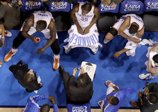 Oklahoma CIty coach Scott Brooks talks with the team during a timeout in game 4 of the Western Conference Finals in the NBA basketball playoffs between the Dallas Mavericks and the Oklahoma City Thunder at the Oklahoma City Arena in downtown Oklahoma City, Monday, May 23, 2011. Dallas won in overtime, 112-105. Photo by Bryan Terry, The Oklahoman ORG XMIT: KOD