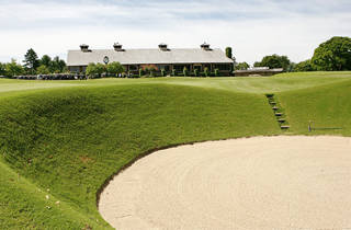 The clubhouse overlooks a bunker at the rededicated Oak Tree National on Wednesday in Edmond. Owners are looking to attract big-time tournaments. Photo by Jim Beckel, The Oklahoman